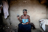 Witchdoctor Maria Comforme (38). For the last 18 years she has been possessed by the spirit of her grandfather Madala, who worked as a policeman in Zimbabwe and was killed in a gunfight.