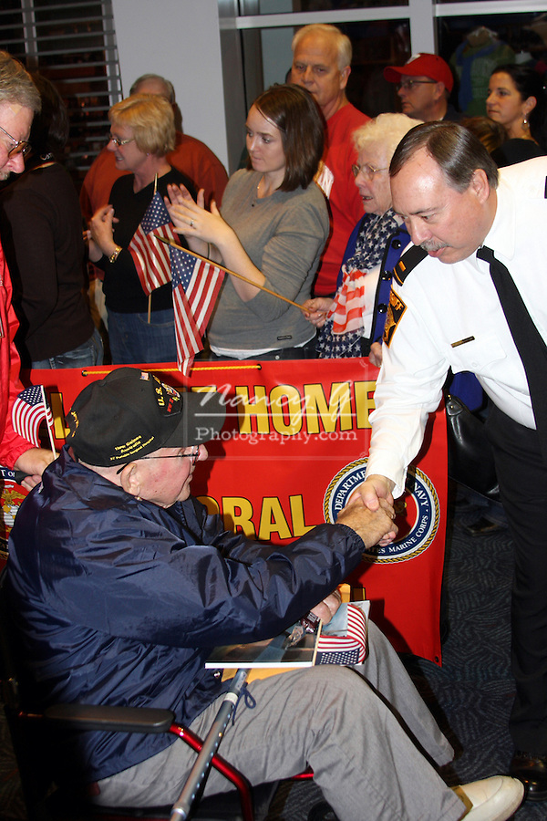 greifenhagen Honor Flight Recoginition for those veterans that fought in World War II, a flight to Washington DC WWII memorial.  Welcome Home Dad sign national pride patriotic hero heroic american united states military support recognize remember those who have served 1945