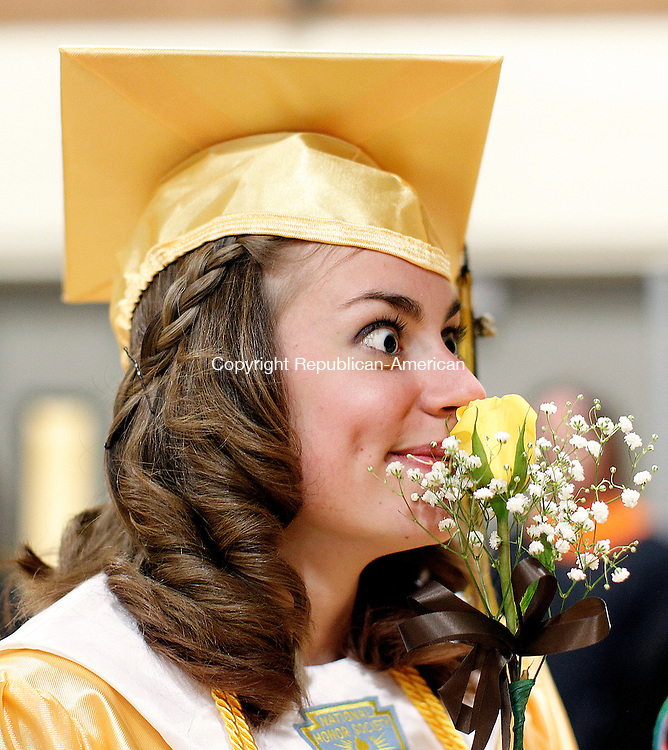 Thomaston, CT-15 June 2012-061512CM07-  Thomaston graduate Kathryn DeFiore smells a yellow rose at commencement exercises Friday night at Thomaston High School.  The 2012 class had 84 graduates.     Christopher Massa Republican-American