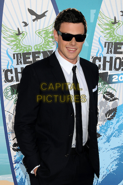 CORY MONTEITH.Teen Choice Awards 2010 - Arrivals held at Universal Studios Gibson Amphitheatre, Universal City, California, USA.August 8th, 2010.half length suit jacket shirt tie sunglasses shades black white.CAP/ADM/BP.©Byron Purvis/AdMedia/Capital Pictures.
