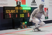 Kim Junghwan (R) of Korea reacts to scoring a point against Aron Szilagyi (not in picture) of Hungary during the final of the Gerevich-Kovacs-Karpati Men's Sabre Grand Prix in Budapest, Hungary on March 09, 2014. ATTILA VOLGYI