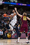 Madison Jones (1) of the Wake Forest Demon Deacons drives to the basket past Elliott Eliason (55) of the Minnesota Golden Gophers during first half action at the LJVM Coliseum on December 2, 2014 in Winston-Salem, North Carolina.  (Brian Westerholt/Sports On Film)