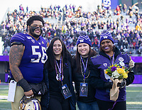 Senior Nick Harris and his loved ones pose before his final game in Husky Stadium.