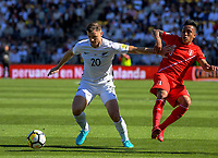 New Zealand's Tommy Smith holds off Peru's Wilder Cartagena during the 2018 FIFA World Cup Russia first-leg playoff football match between the NZ All Whites and Peru at Westpac Stadium in Wellington, New Zealand on Saturday, 11 November 2017. Photo: Dave Lintott / lintottphoto.co.nz