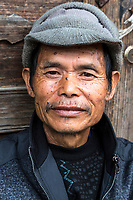 Huanggang, Guizhou, China.  Middle-aged Man of the Dong Ethnic Minority.