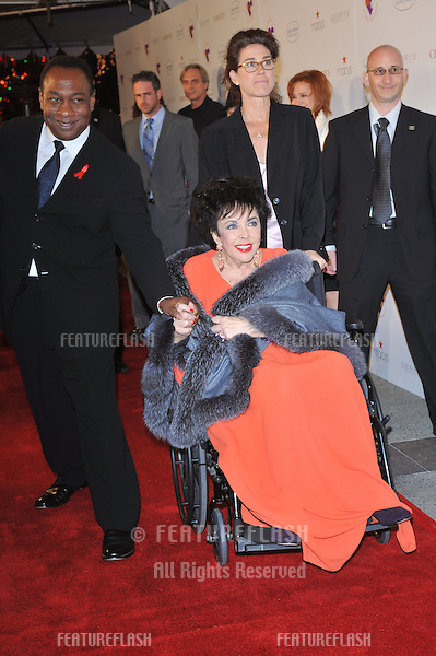 """Dame Elizabeth Taylor & Jason Winters at the World AIDS Day presentation of """"Love Letters"""" at the Paramount Theatre, Hollywood..December 1, 2007  Los Angeles, CA.Picture: Paul Smith / Featureflash"""