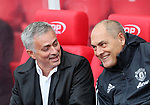 Manchester United's Jose Mourinho shares a joke during the premier league match at the Britannia Stadium, Stoke on Trent. Picture date 9th September 2017. Picture credit should read: David Klein/Sportimage
