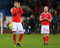 (L-R) Hal Robson-Kanu of Wales applauds home supporters with team mate Jonathan Williams during the FIFA World Cup Qualifier Group D match between Wales and Republic of Ireland at The Cardiff City Stadium, Wales, UK. Monday 09 October 2017