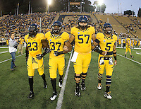 California captains' Josh Hill, Robert Mullins, Brian Schwenke and Michael Lowe walk on the field for coin toss before the game against Washington at Memorial Stadium in Berkeley, California on November 2nd, 2012.  Washington Huskies defeated California, 13-21.