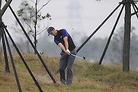 Ross Fisher (ENG) plays his 2nd shot the rough on the 3rd hole during Thursday's Round 1 of the 2014 BMW Masters held at Lake Malaren, Shanghai, China 30th October 2014.<br /> Picture: Eoin Clarke www.golffile.ie