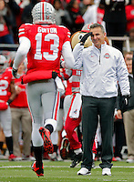 Ohio State Buckeyes head coach Urban Meyer salutes Ohio State Buckeyes quarterback Kenny Guiton (13) during  senior day before the start of their game against Indiana Hoosiers at Ohio Stadium in Columbus, Ohio on November 23, 2013.  (Dispatch photo by Kyle Robertson)