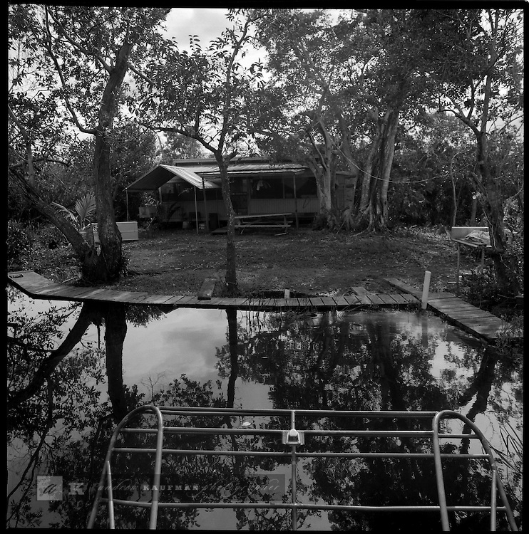1997-The Duck Club an island and hunting club south of the Tamiami trail only accessible by airboat. The Florida Everglades are a disappearing world. Overpopulation, the sugar and cattle industry, mismanagement of the land, droughts and bush fires are just a few of the problems the Florida Everglades are facing. Here Glen Wilsey driving his airboat. According to Glen the best thing about being a tour guide in the everglades is driving the airboats. Riding an airboat is fun but driving an airboat is an awesome feeling.