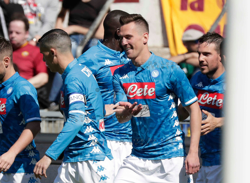 Arkadiusz Milik of Napoli   celebrates after scores during the  italian serie a soccer match, AS Roma -  SSC Napoli       at  the Stadio Olimpico in Rome  Italy , March 31, 2019