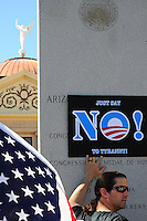 "Phoenix, Arizona. January 19, 2013 - A man holds a sign similar to those used by Obama's 2012 presidential campaign to oppose the president's proposed changes to gun laws. As President Barack Obama proposed new gun regulations last week, gun owners demonstrated against it with national ""Guns Across America"" rallies to defend the Second Amendment. Dozens showed up at the Arizona State Capitol, many of them carrying weapons. Photo by Eduardo Barraza © 2013"