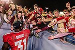 Seminole Terrence Brooks gets mobbed after the BCS national title game at the Rose Bowl in Pasadena, California on January 6, 2014.  Florida State Seminoles defeated the Auburn Tigers 34-31.
