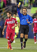 Chicago Fire midfielder Daniel Paladini, left, gets a red card from referee Alex during play between the Seattle Sounders FC and the Chicago Fire in the U.S. Open Cup Final at CenturyLink Field in Seattle Tuesday October 4, 2011. Seattle won the game 2-0 to win its third U.S. Open Cup.