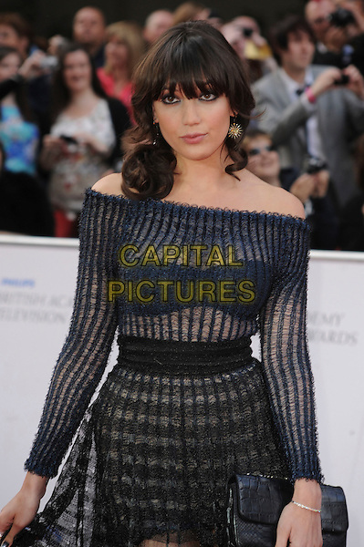 DAISY LOWE .Attending the Philips British Academy Television Awards, Grosvenor house Hotel, Park Lane, London, England, UK, May 22nd 2011..arrivals TV Baftas Bafta half length black sheer see thru through dress striped  clutch bag  off the shoulders  bra  knickers navy fringe .CAP/WIZ.© Wizard/Capital Pictures.