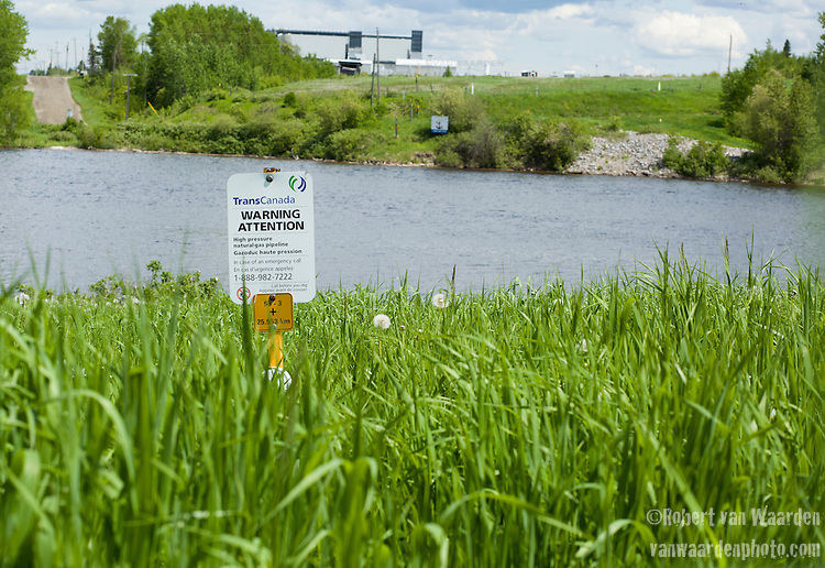 The TransCanada mainline, including the pipe that would be the proposed Energy East pipeline crosses the Kapuskasing River in Northern Ontario. According to one resident that lives beside the pipeline, when TransCanada installed the pipe they simply laid it on the bottom of the river rather than bury it because it was much cheaper. (Credit: Robert van Waarden - http://alongthepipeline.com)