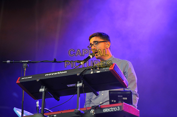 Gus Unger-Hamilton of Alt-J<br /> Performing at Glastonbury Festival, Worthy Farm, Pilton, Somerset, <br /> England, UK, 28th June 2013.<br /> half length microphone singing playing keyboards live on stage concert gig glasses <br /> CAP/MAR<br /> &copy; Martin Harris/Capital Pictures