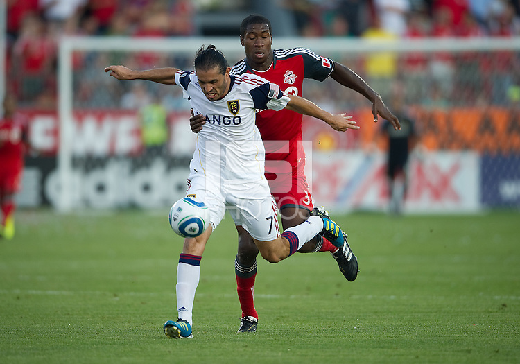 13 August 2011: Real Salt Lake forward Fabian Espindola #7 and Toronto FC defender Andy Iro #3 in action during a game between Real Salt Lake and Toronto FC at BMO Field in Toronto.