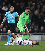 Manchester City's Ederson checks on the well-being of Tottenham Hotspur's Dele Alli<br /> <br /> Photographer Rob Newell/CameraSport<br /> <br /> UEFA Champions League Quarter-finals 1st Leg - Tottenham Hotspur v Manchester City - Tuesday 9th April 2019 - White Hart Lane - London<br />  <br /> World Copyright © 2018 CameraSport. All rights reserved. 43 Linden Ave. Countesthorpe. Leicester. England. LE8 5PG - Tel: +44 (0) 116 277 4147 - admin@camerasport.com - www.camerasport.com