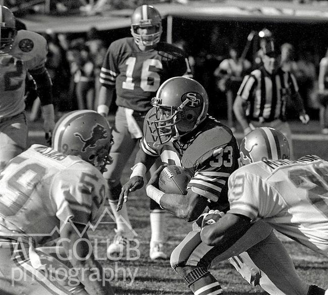 San Francisco 49ers vs. Detroit Lions at Candlestick Park Saturday, December 31, 1983..49ers beat the Lions 24-23.San Francisco 49er Running Back Roger Craig out runs the Lion defense...