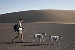 KUNENE, NAMIBIA - APRIL 29: Rudy Loutit, age 64, a park ranger, walks with his Dalmatian dogs in the Namib Desert close the Sand Dunes at Skeleton Coast on April 29, 2008 in Kunene, Namibia. Mr. Loutit did a 2-week survey with a walking safari with camels and a crew through 155 miles of proposed parkland through the savanna at Etosha National park, through rocky badlands, across the world's oldest desert, the Namib and the blinding dunes and fogy cliffs at Skeleton Coast on the Atlantic Ocean. Rudy has worked for over three decades to save the black rhinoceros from extinction through his organization, Save The Rhino Trust. The black rhino is now brought back from certain extinction and more than one hundred fifty of them roam this remote area. (Photo by Per-Anders Pettersson)....