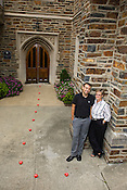 Director of the Center for LGBT Life at Duke University Janie Long, right, and Program Coordinator Christopher Purcell, left, outside the center's doors on the campus of Duke University.