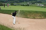 Shane Lowry  playing out of the bunker on the 16th on day three of the Celtic Manor Wales Open 2010.Picture Fran Caffrey/Newsfile.ie