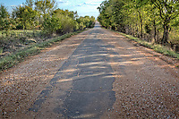 "Just outside of Miami is the last section of the original nine foot wide ""Ribbon Road"" that is listed as an Oklahoma National Historic Landmark. This section of the road predates Route 66, having been built in the early 1920's. Legend has it that when the road was built, Oklahoma's budget was tight, so rather than covering half the mileage, they covered half the width. This remarkable piece of vintage pavement zigzags for 13 miles between Miami and Afton."