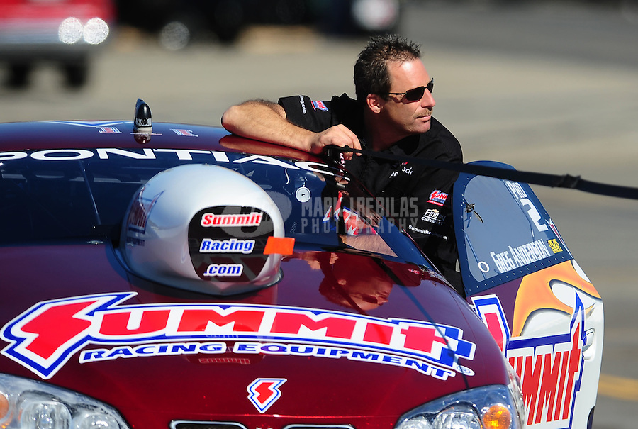 Nov 12, 2010; Pomona, CA, USA; NHRA pro stock driver Greg Anderson during qualifying for the Auto Club Finals at Auto Club Raceway at Pomona. Mandatory Credit: Mark J. Rebilas-