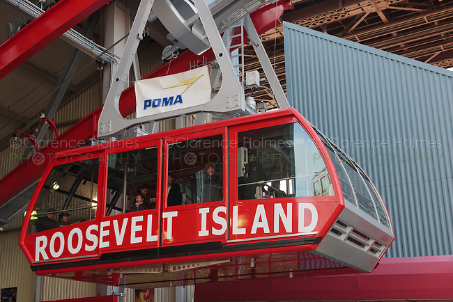 The newly renovated Roosevelt Island Tram approaches the Roosevelt Island station