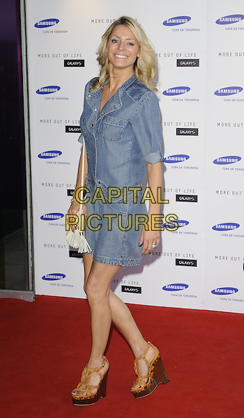 TESS DALY .attends the launch of the Samsung Galaxy S Smartphone held at Altitude Bar, London, England, UK, .June 15th, 2010. .full length dress shirt blue denim brown tan platform sandals wooden wedges white bag .CAP/CAN.©Can Nguyen/Capital Pictures.