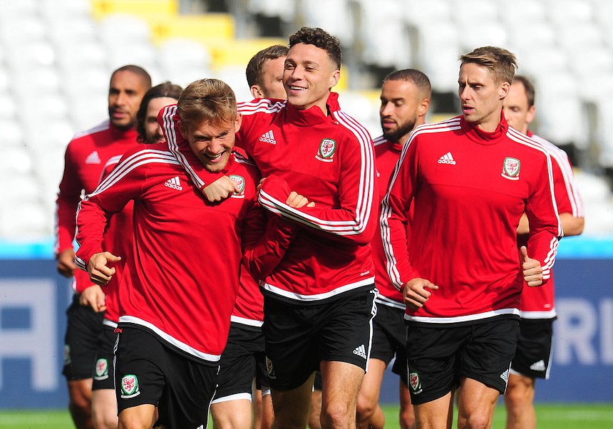 Wales's James Chester with George Williams during todays training session<br /> <br /> Photographer Kevin Barnes/CameraSport<br /> <br /> International Football - 2016 UEFA European Championship - Training Session - Group B - England v Wales - Wednesday, 15th June 2016 - Stade Bollaert-Delelis, Lens Agglo, France<br /> <br /> World Copyright &copy; 2016 CameraSport. All rights reserved. 43 Linden Ave. Countesthorpe. Leicester. England. LE8 5PG - Tel: +44 (0) 116 277 4147 - admin@camerasport.com - www.camerasport.com