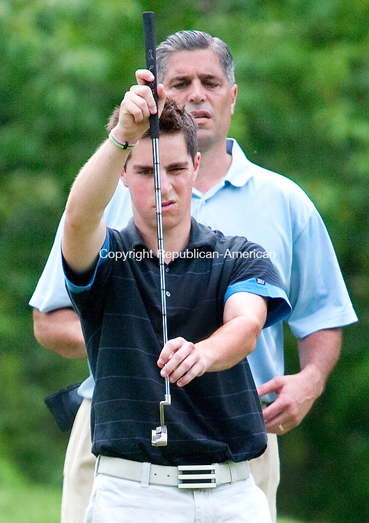 WATERBURY, CT. 23 June 2010-062310SV05--Nick Taylor of Heritage Village Country Club lines up a putt with his dad Jim Taylor, who was caddying for him, during the 108th Connecticut Amateur Championship at The Country Club of Waterbury in Waterbury Wednesday.<br /> Steven Valenti Republican-American