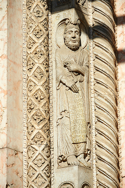 Sculptures of one of the prophets who fortold the coming of Christ and pillars of the archivolts on the main portal of the of the 12th century Romanesque Ferrara Duomo, Italy