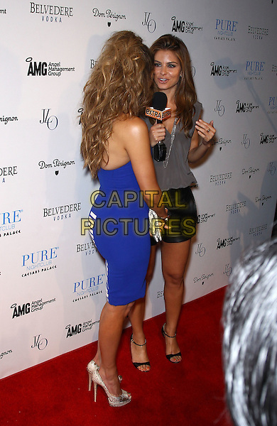 Jennifer Lopez & Maria Menounos.Jennifer Lopez celebrates world tour with post concert party at Pure Nightclub inside Caesars Palace, Las Vegas, Nevada, USA..August 18th, 2012.full length blue strapless dress white back behind rear grey gray sleeveless top black leather shorts interview microphone stripe .CAP/ADM/MJT.© MJT/AdMedia/Capital Pictures.