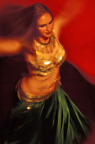 Professional belly dancer Noura twirls during the finale of her veil dance at Al Masri Egyptian Restaurant in San Francisco. (photo by Pico van Houtryve)