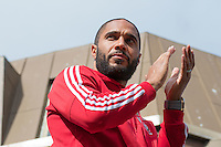 CARDIFF, UK. 8th July 2016. The Welsh football team are welcomed home with a public celebration event after reaching the semi-final of the Euro 2016 championship. After landing at Cardiff airport, an open-top bus parade took them through the city centre.<br /> <br /> Pictured: Ashley Williams