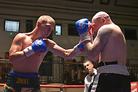 Jimmy Smith (green shorts) defeats Lewis Van Poetsch during a Boxing Show at York Hall on 30th June 2018