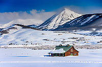 While known for its skiing and mountain biking, Crested Butte, Colorado is still surrounded by working ranches and farmland. Here, a barn east of town catches morning light in the valley.
