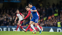 Pedro of Chelsea & Grzegorz Krychowiak of WBA during the Premier League match between Chelsea and West Bromwich Albion at Stamford Bridge, London, England on 12 February 2018. Photo by Andy Rowland.