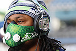 Seattle Seahawks running back Marshawn Lynch wears a training mask during the pregame warmup before an NFL game against the Arizona Cardinals.
