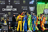 #18: Kyle Busch, Joe Gibbs Racing, Toyota Camry M&M's, celebrates after winning 2019 Monster Energy Cup Series Championship.