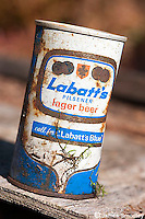 Unusual old beer cans found as litter in the forest.