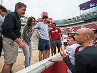 Hawgs Illustrated/BEN GOFF <br /> Justin Stepp, Arkansas wide receivers coach, and receiver Jackson Salley greet Salley's family Saturday, April 6, 2019, after the Arkansas Red-White game at Reynolds Razorback Stadium.