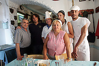 Massimo Del Canale, al centro, con cappello e grembiule bianco, chef della trattoria La Lanterna, posa col personale, a a Riomaggiore, uno dei borghi delle Cinque Terre.<br /> Massimo Del Canale, center, with white hat and smock, chef of the restaurant La Lanterna in Riomaggiore, at the Cinque Terre, poses with the staff of the restaurant.<br /> UPDATE IMAGES PRESS/Riccardo De Luca