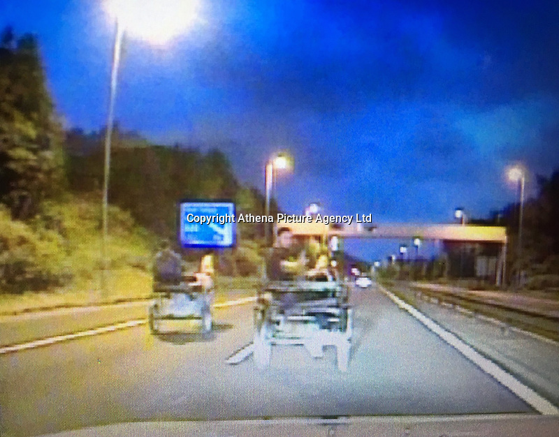 "Pictured: The two carts riden by two men on the M4 motorway near Port Talbot, Wales, UK.<br /> Re: Two men have been pictured racing a horse and traps on the M4 motorway while apparently drunk.<br /> South Wales Police said the carts were seen riding on the M4 near Port Talbot early on Sunday.<br /> Two men have been summoned to appear before court following the incident, a police spokesman has said.<br /> South Wales Police's roads unit tweeted ""thankfully no-one hurt"" as the carts were seen riding between the Margam and Aberavon junctions."