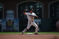 SAN FRANCISCO, CA - APRIL 8:  Joe Panik #12 of the San Francisco Giants turns a double play at second base against the Los Angeles Dodgers during the game at AT&T Park on Sunday, April 8, 2018 in San Francisco, California. (Photo by Brad Mangin)