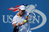 Novak Djokovic of Serbia returns a shot against Kei Nishikori of Japan during men semifinal match at the US Open 2014 tennis tournament in the USTA Billie Jean King National Center, New York.  09.05.2014. VIEWpress